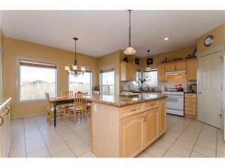 Photo 9: 76 STRATHLEA Place SW in Calgary: Strathcona Park House for sale : MLS®# C4092293