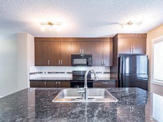 Photo 8: 70 Auburn Bay Link SE in Calgary: Auburn Bay Row/Townhouse for sale : MLS®# A1102367