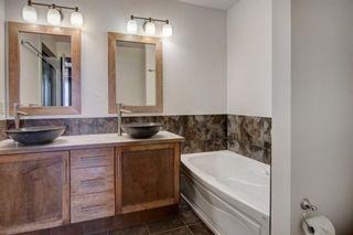 Photo 12: 2315 1 Street NE in Calgary: Tuxedo Park Row/Townhouse for sale : MLS®# A1086504