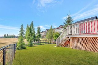 Photo 4: 567 PANAMOUNT Boulevard NW in Calgary: Panorama Hills Semi Detached for sale : MLS®# A1047979