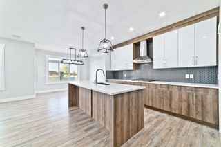 Photo 5: 110 Creekside Way SW in Calgary: C-168 Detached for sale : MLS®# A1144318