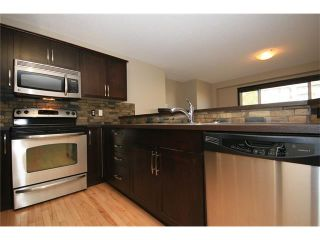 Photo 12: 81 SUNSET Heights: Cochrane House for sale : MLS®# C4072364