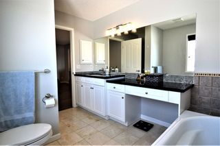 Photo 21: 7476 Springbank Way SW in Calgary: Springbank Hill Detached for sale : MLS®# A1071854