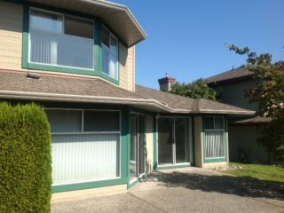 "Photo 13: 124 16080 82ND Avenue in Surrey: Fleetwood Tynehead Townhouse for sale in ""Ponderosa Estates"" : MLS®# F1321774"