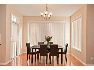 Photo 9: 36 CIMARRON ESTATES Way: Okotoks House for sale : MLS®# C4040427