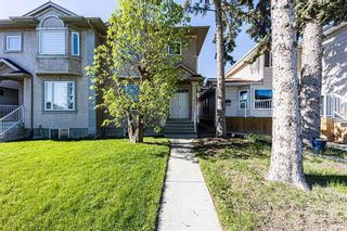 Photo 1: 415 52 Avenue SW in Calgary: Windsor Park Semi Detached for sale : MLS®# A1112515