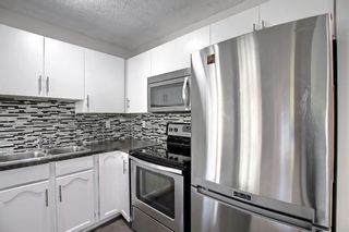 Photo 5: 29 Country Hills Rise NW in Calgary: Country Hills Row/Townhouse for sale : MLS®# A1149774