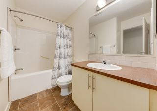 Photo 21: 402 2445 Kingsland Road SE: Airdrie Row/Townhouse for sale : MLS®# A1107683