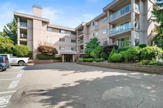 """Photo 1: 107 33110 GEORGE FERGUSON Way in Abbotsford: Central Abbotsford Condo for sale in """"Tiffany Park"""" : MLS®# R2575880"""