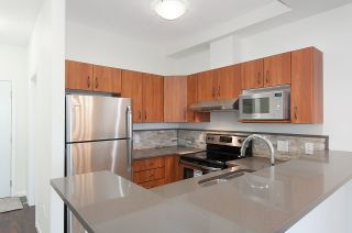 "Photo 1: 404 20200 56 Avenue in Langley: Langley City Condo for sale in ""The Bentley"" : MLS®# R2116212"
