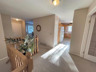 Photo 7: 15 Coach Side Terrace SW in Calgary: Coach Hill Row/Townhouse for sale : MLS®# A1071978