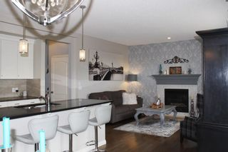 Photo 2: 377 River Heights Drive: Cochrane Detached for sale : MLS®# A1106134