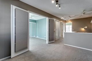 Photo 27: 91 Patina Rise SW in Calgary: Patterson Row/Townhouse for sale : MLS®# A1071867