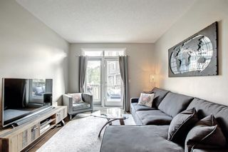 Photo 5: 1103 125 Panatella Way NW in Calgary: Panorama Hills Row/Townhouse for sale : MLS®# A1143179