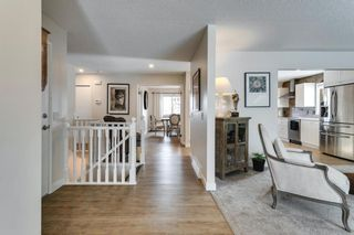Photo 19: 84 Coach Side Terrace SW in Calgary: Coach Hill Semi Detached for sale : MLS®# A1077504
