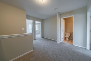 Photo 20: 404 720 Willowbrook Road NW: Airdrie Row/Townhouse for sale : MLS®# A1098346
