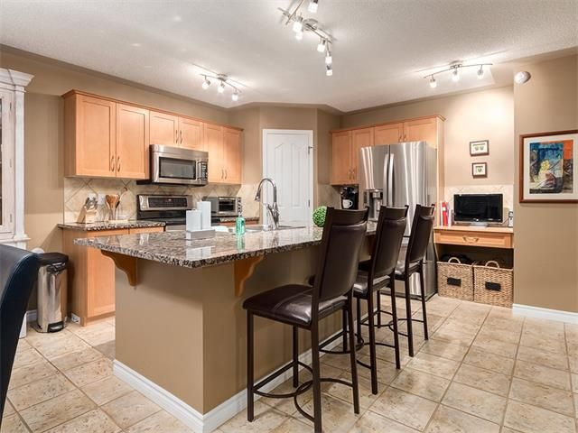 Photo 6: Photos: 40 COUGARSTONE Manor SW in Calgary: Cougar Ridge House for sale : MLS®# C4087798