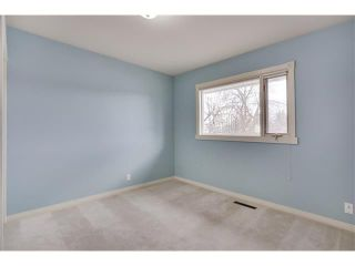 Photo 15: 3039 CANMORE Road NW in Calgary: Banff Trail House for sale