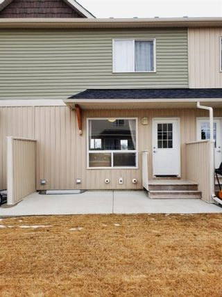 Photo 4: 1402 Clover Link: Carstairs Row/Townhouse for sale : MLS®# A1092269