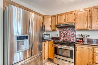Photo 11: 210 Arbour Cliff Close NW in Calgary: Arbour Lake Semi Detached for sale : MLS®# A1086025