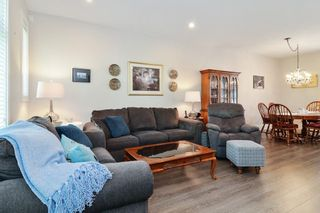 """Photo 4: 82 7665 209 Street in Langley: Willoughby Heights Townhouse for sale in """"Archstone"""" : MLS®# R2594119"""