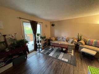 Photo 7: 10 1706 22 Avenue: Didsbury Row/Townhouse for sale : MLS®# A1110698