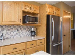 Photo 8: 114 SUNDOWN Close SE in CALGARY: Sundance Residential Detached Single Family for sale (Calgary)  : MLS®# C3601498