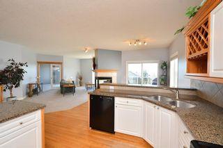 Photo 12: 303 GLENEAGLES View: Cochrane House for sale : MLS®# C4130061