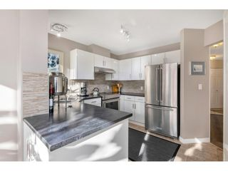 """Photo 12: 232 13900 HYLAND Road in Surrey: East Newton Townhouse for sale in """"Hyland Grove"""" : MLS®# R2519167"""