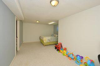 Photo 38: 41 BRIDLERIDGE Gardens SW in Calgary: Bridlewood House for sale : MLS®# C4135340