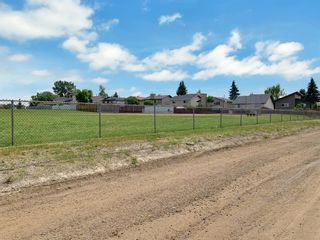 Photo 7: 716 Acacia Crescent SE: Airdrie Detached for sale : MLS®# A1143924
