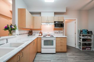 """Photo 7: 103 15298 20 Avenue in Surrey: King George Corridor Condo for sale in """"Waterford House"""" (South Surrey White Rock)  : MLS®# R2624837"""