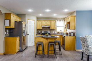 Photo 10: 61 TUSCANY Way NW in Calgary: Tuscany Detached for sale : MLS®# A1034798