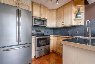 Photo 13: 411 1540 17 Avenue SW in Calgary: Sunalta Apartment for sale : MLS®# A1123160
