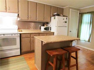 """Photo 3: 11 8420 ALASKA Road in Fort St. John: Fort St. John - City SE Manufactured Home for sale in """"PEACE COUNTRY MOBILE HOME PARK"""" (Fort St. John (Zone 60))  : MLS®# N232167"""
