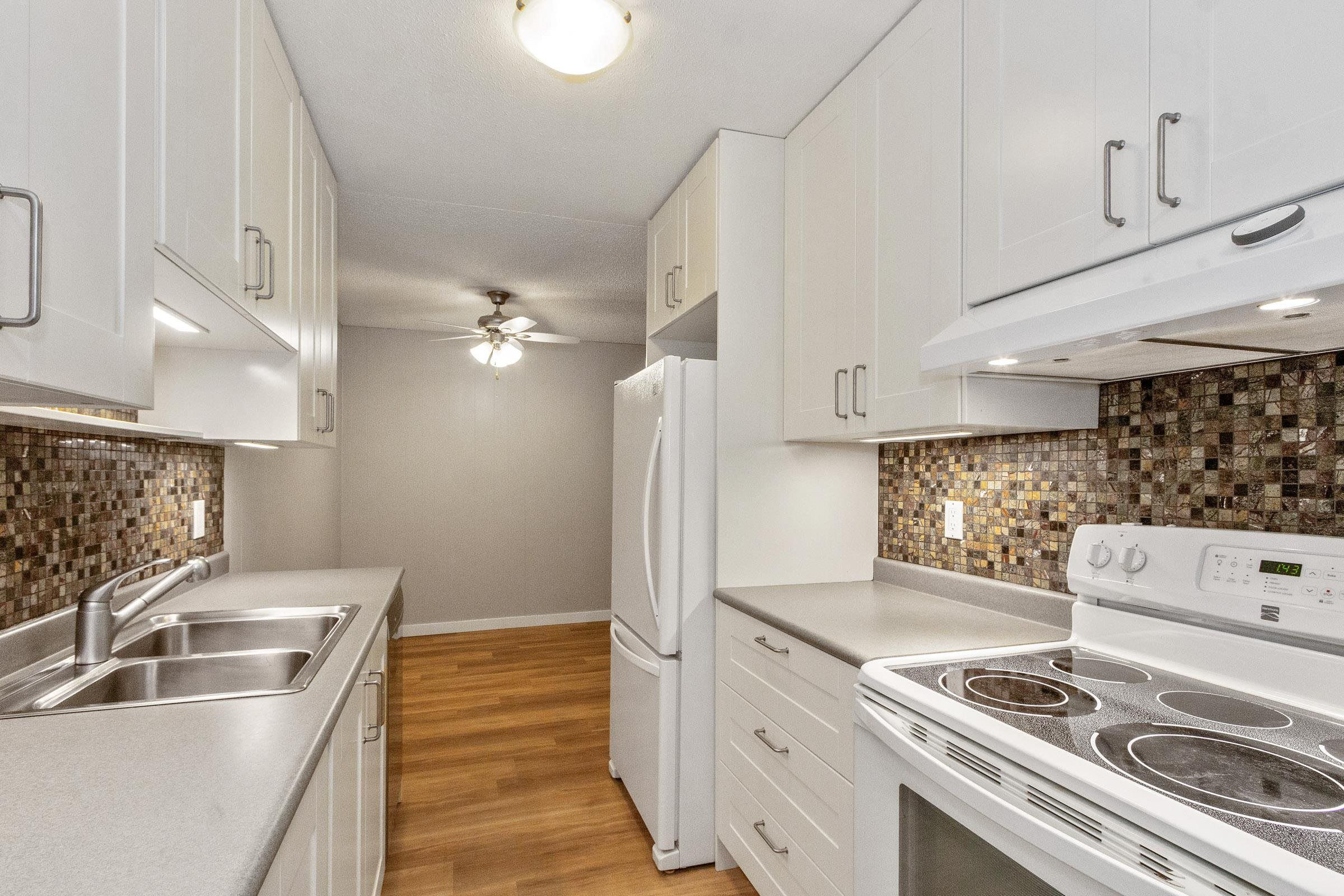 """Main Photo: 115 3921 CARRIGAN Court in Burnaby: Government Road Condo for sale in """"LOUGHEED ESTATES"""" (Burnaby North)  : MLS®# R2610638"""