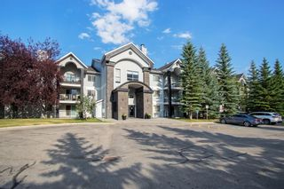 Photo 2: 204 2022 CANYON MEADOWS Drive SE in Calgary: Queensland Apartment for sale : MLS®# A1028195