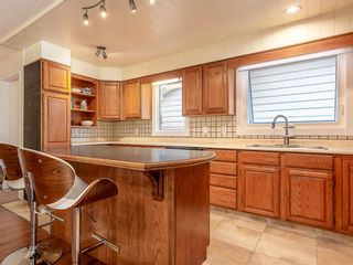 Photo 11: 5451 Silverdale Drive NW in Calgary: Silver Springs Detached for sale : MLS®# A1011333