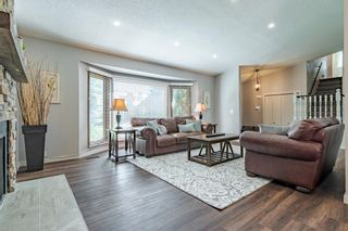 Photo 5: 884 Coach Side Crescent SW in Calgary: Coach Hill Detached for sale : MLS®# A1105957