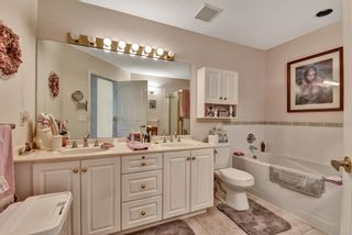 """Photo 14: 7 16888 80 Avenue in Surrey: Fleetwood Tynehead Townhouse for sale in """"STONECROFT"""" : MLS®# R2610789"""
