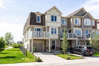 Photo 2: 145 WINDSTONE Avenue SW: Airdrie Row/Townhouse for sale : MLS®# C4260990