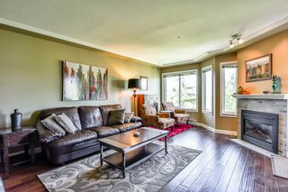 Photo 5: 404 20453 53 Avenue in Langley: Langley City Condo for sale : MLS®# R2186113