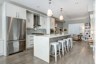 Photo 1: 2614 19 Avenue SW in Calgary: Richmond Row/Townhouse for sale : MLS®# A1086185