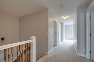 Photo 18: 2 10 St Julien Drive SW in Calgary: Garrison Woods Row/Townhouse for sale : MLS®# A1146015