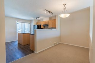 Photo 12: 119 Toscana Gardens NW in Calgary: Tuscany Row/Townhouse for sale : MLS®# A1121039