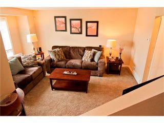 Photo 12: 94 123 QUEENSLAND Drive SE in Calgary: Queensland House for sale : MLS®# C4027673