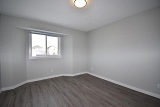 Photo 8: 58 Rivercrest Place SE in Calgary: Riverbend Detached for sale : MLS®# A1076543