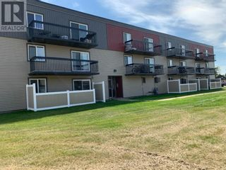 Photo 1: 22, 616 Main  Street NW in Slave Lake: Condo for sale : MLS®# A1142793