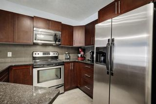 Photo 7: 217 500 ROCKY VISTA NW in Calgary: Rocky Ridge Apartment for sale : MLS®# A1084789