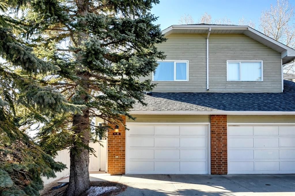 Main Photo: 31 Stradwick Place SW in Calgary: Strathcona Park Semi Detached for sale : MLS®# A1119381